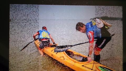 Team mates Marcel and Simone entering their kayak