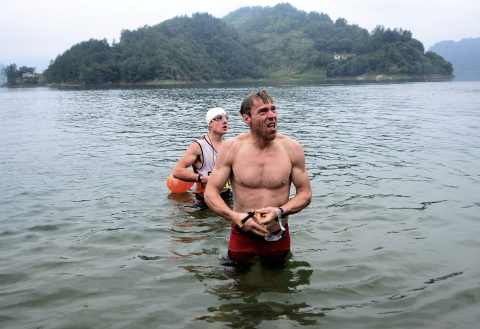 Marcel and I getting told off for warming up in the lake prior to the start of Day 3